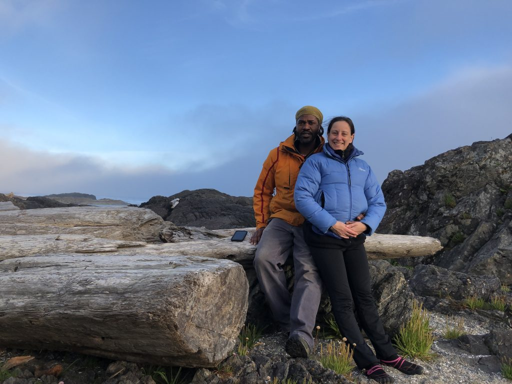 Man and woman posed in mountains