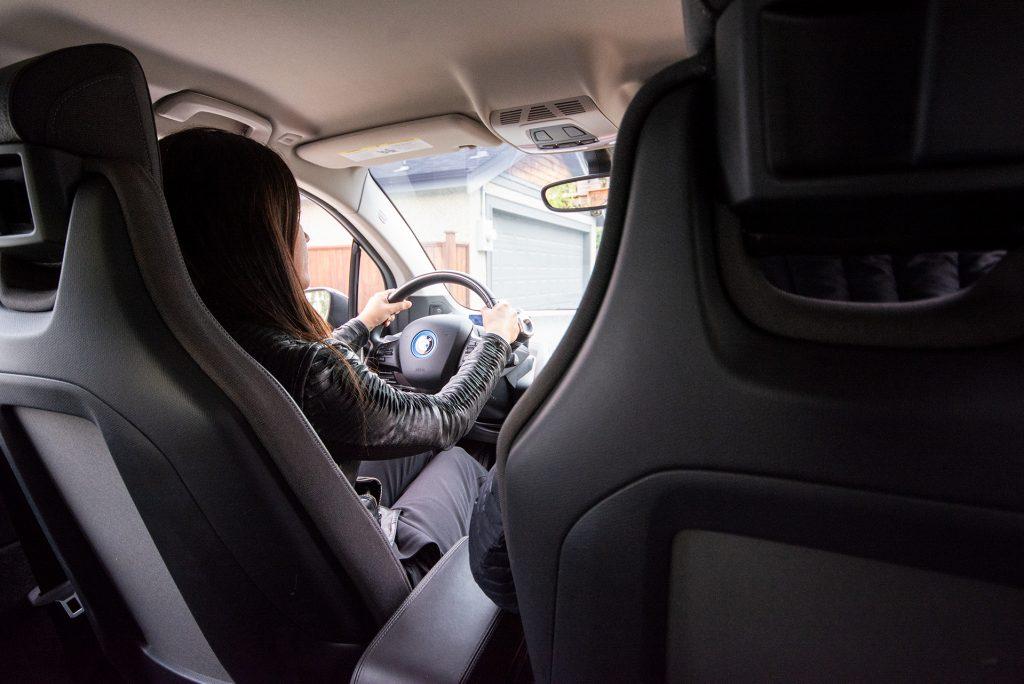 Woman driving electric car